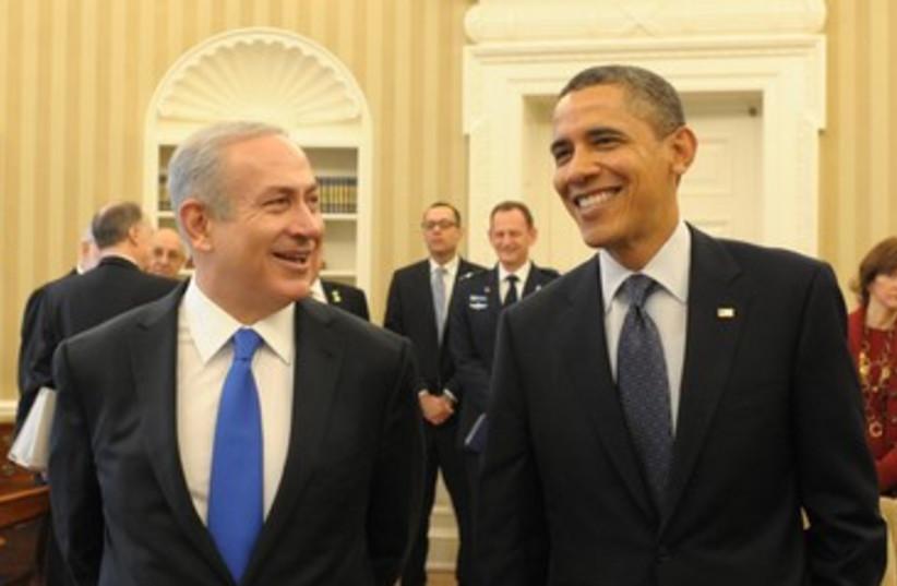 Obama Netanyahu smiling happy meeting 390 (photo credit: Amos Ben Gershom / GPO)