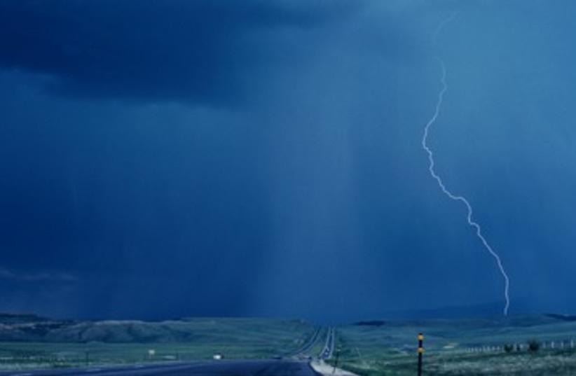 Rain and lightnight on farmland 390 (photo credit: Thinkstock/Imagebank)