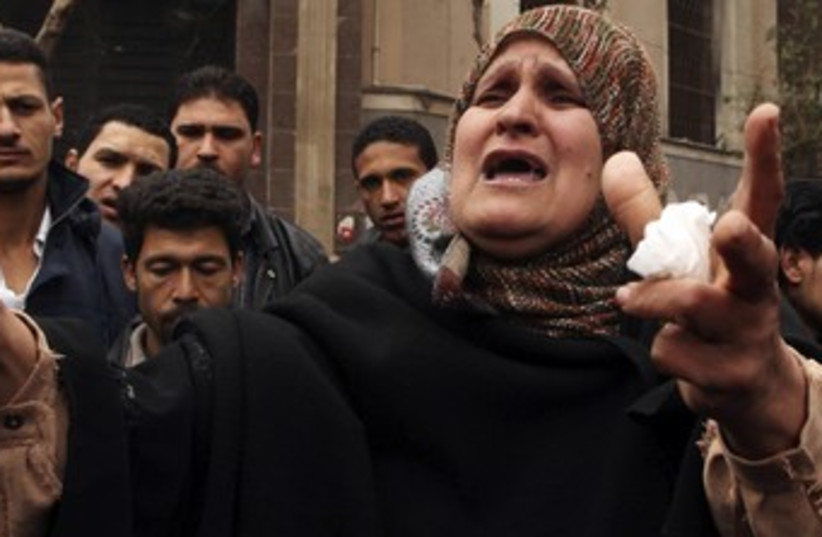 Woman shouts about political situation (photo credit: Reuters/Mohammed Salem)