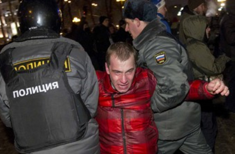 Russian Protester 370 R (photo credit: REUTERS/Thomas Peter)
