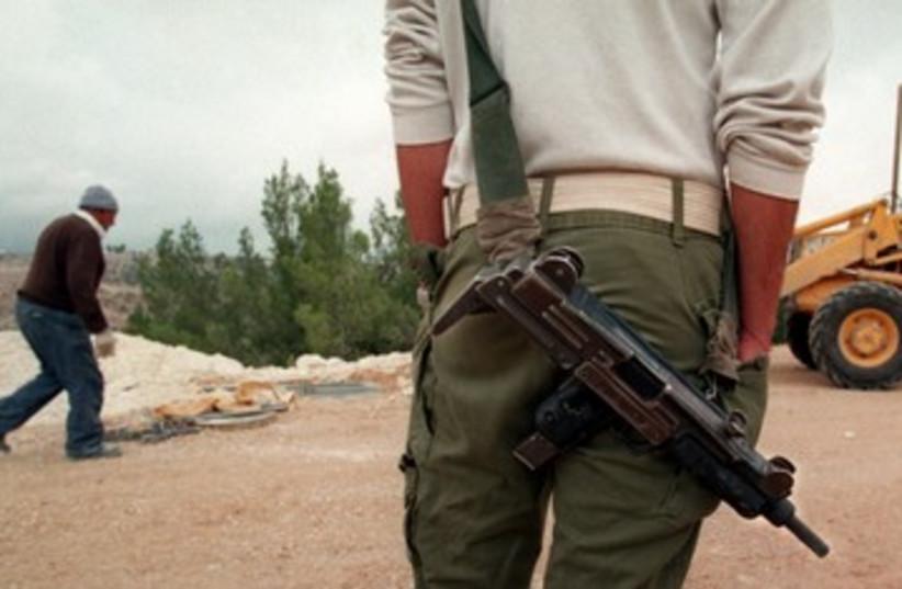 IMI manufactured Uzi sub-machinegun 390 (R) (photo credit: Reuters)