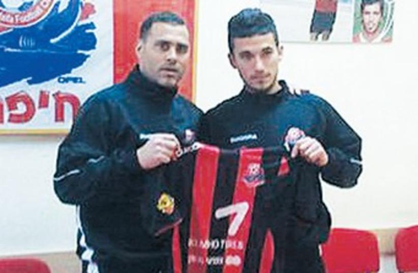 ALI KHATIB and coach Tal Banin 370 (photo credit: Hapoel Haifa website)