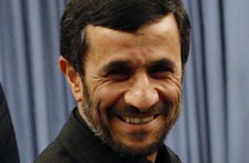 Ahmadinejad smiles 224.8 (photo credit: AP)