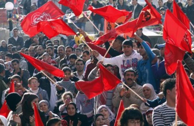 Palestinains rally for the PFLP 390 (photo credit: REUTERS/Abed Omar Qusini)