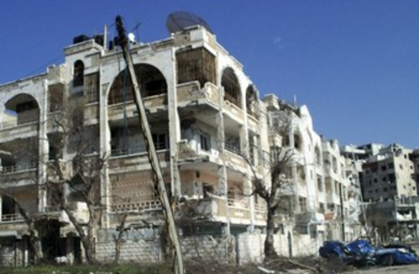 Damaged houses, vehicles in Homs, Syria_370 (photo credit: Reuters)