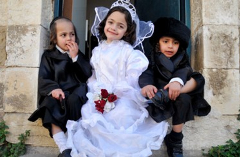 Haredi kids in Purim costumes (photo credit: Hadas Parush)
