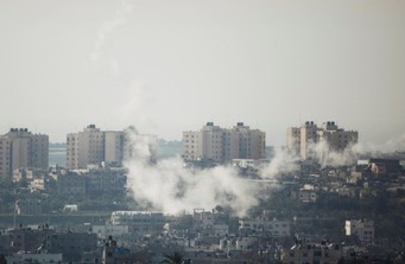 Rockets fired from Gaza smoke 390 (photo credit: REUTERS)