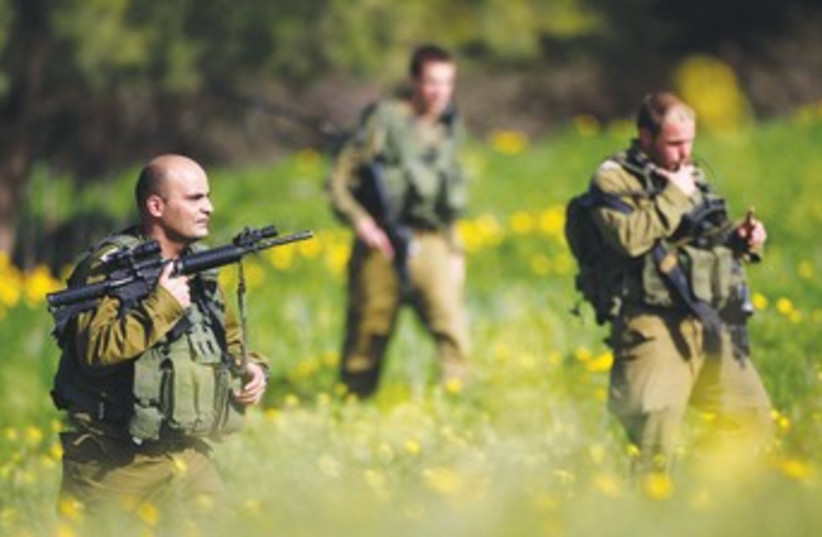 IDF soldiers near Ashkelon search for rockets_370 (photo credit: Amir Cohen/Reuters)
