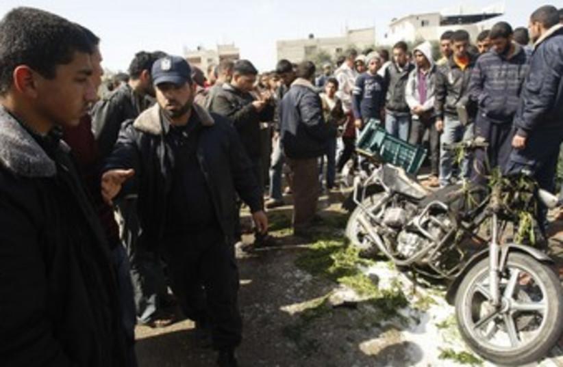 Hamas policeman near exploded motorcycle in Gaza_370 (photo credit: Ibraheem Abu Mustafa/Reuters)