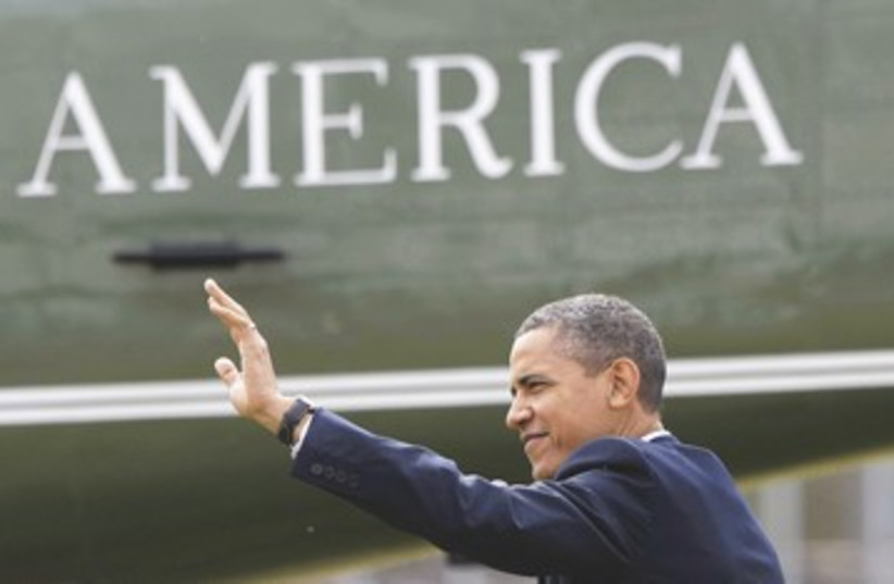 Obama next to words 'America' 390 (photo credit: Reuters)