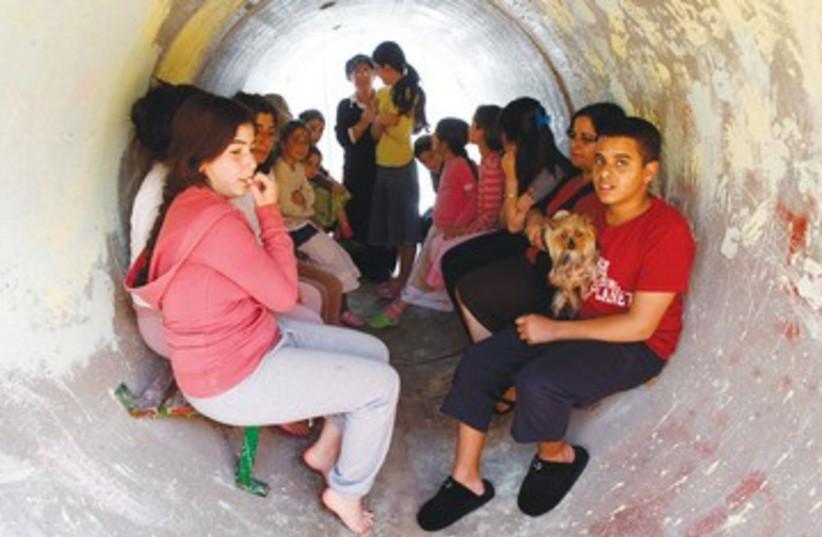 Nitzana residents seek refuge in sewage pipe 390  (photo credit: REUTERS)