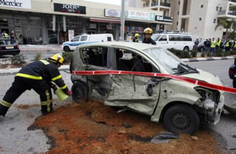Car damaged from Gaza rocket 390 (photo credit: REUTERS/Nir Elias)