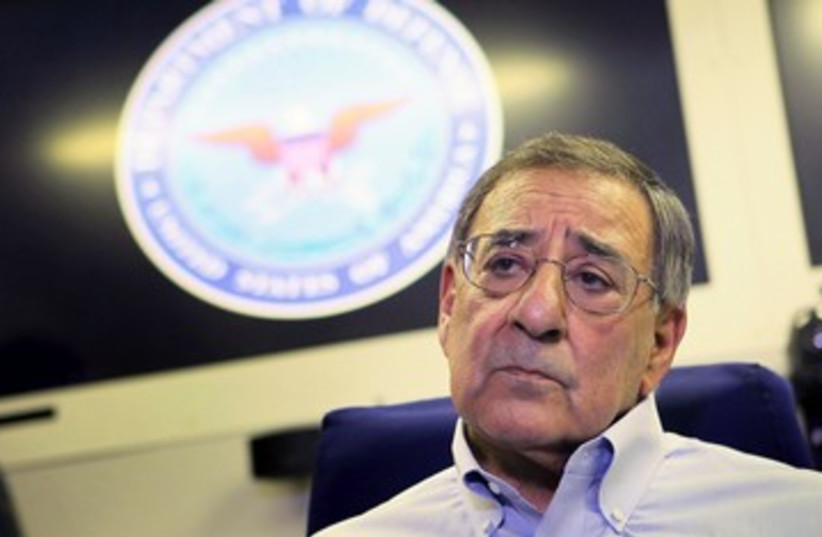 Leon Panetta speaks with reporters on a plane 390 (R) (photo credit: REUTERS/Scott Olson/Pool)