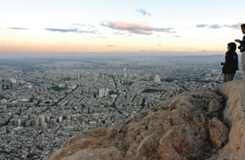 View of Damascus from Mt. Qassyoun  (photo credit: Reuters)