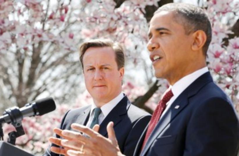 President Barack Obama w UK PM David Cameron 390 R (photo credit: REUTERS/Jason Reed )