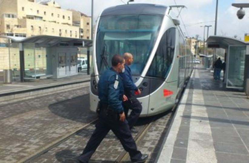 police circle Jerusalem light rail_370 (photo credit: Melanie Lidman)