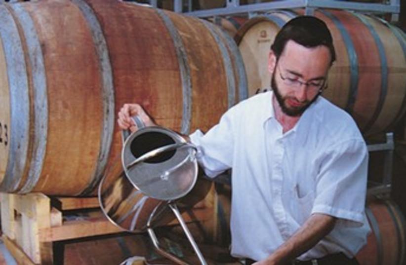 Relgious man making wine 370 (photo credit: Dani Kronenberg)