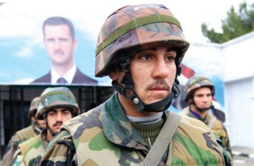 Syrian soldiers attend funeral 370 (photo credit: Reuters)