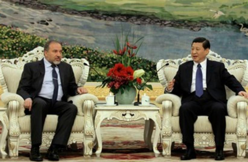 Liberman and China's Vice President Xi Jinping 370 (photo credit: Azriel Shnitzer)