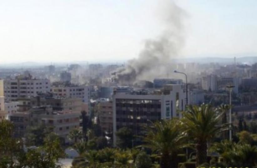Smoke rises in Damascus 370 (photo credit: REUTERS)