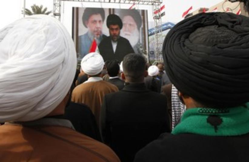 Supporters watch a Moqtada al-Sadr speech 370 (R) (photo credit: Mohammed Ameen / Reuters)