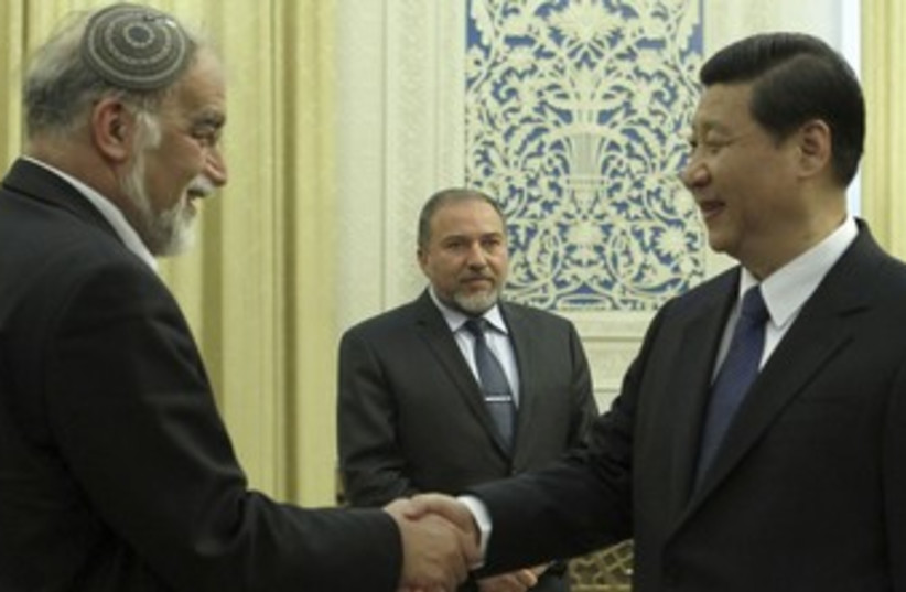 Liberman looks on as Chinese VP Xi Jinping meets Rotem_370 (photo credit: Reuters/China Daily)