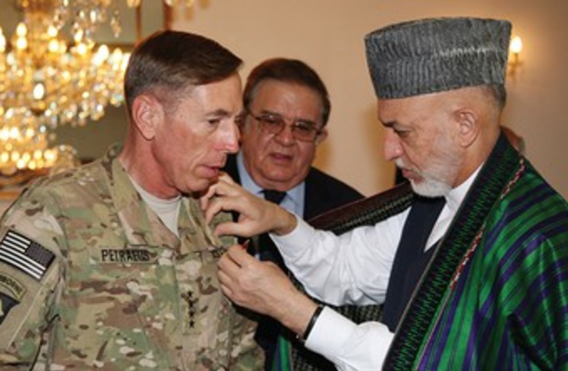 Afghan President Karzai with then Gen. Petraeus 370 (R) (photo credit: Reuters)