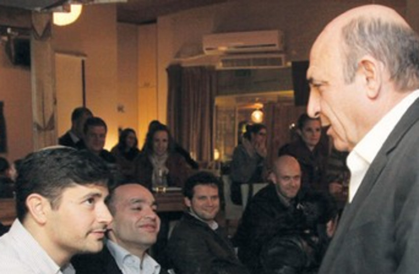 Mofaz shakes hands with supporters 370 (photo credit: Marc Israel Sellem/The Jerusalem Post)