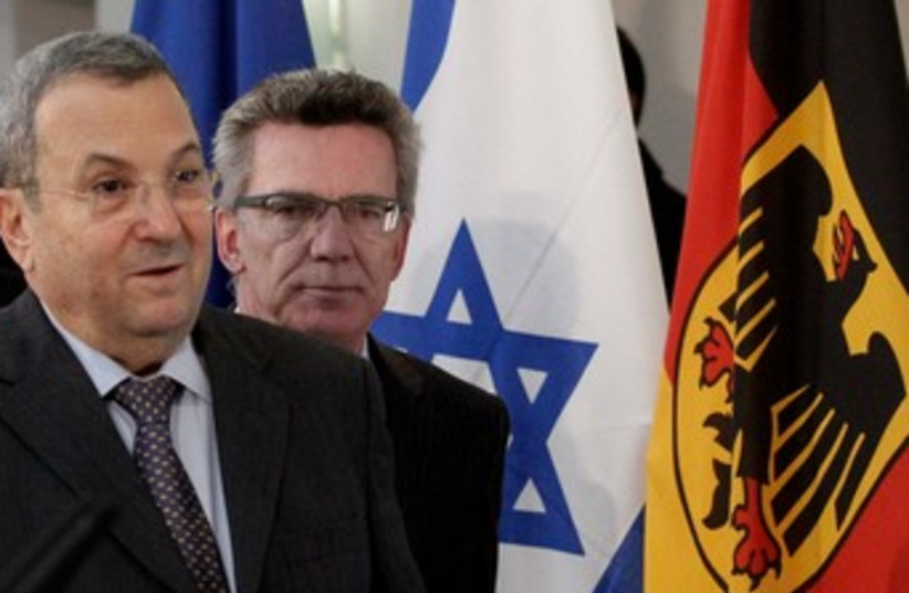 Barak and de Maiziere 370 (photo credit: REUTERS)