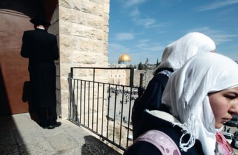 Arab women an haredi man in Jerusalem 370 (photo credit: REUTERS)