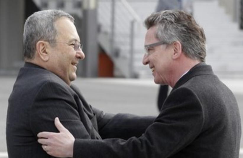 German Foreign Minister welcomes Ehud Barak 370 (photo credit: REUTERS)