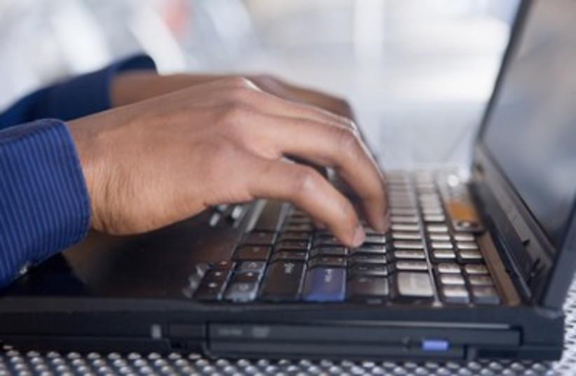 Man on computer 390 (photo credit: Thinkstock/Imagebank)