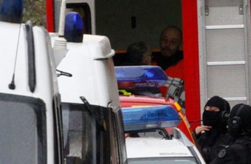 French police at scene of Toulouse standoff 370 (R) (photo credit: REUTERS/Jean-Paul Pelissier)
