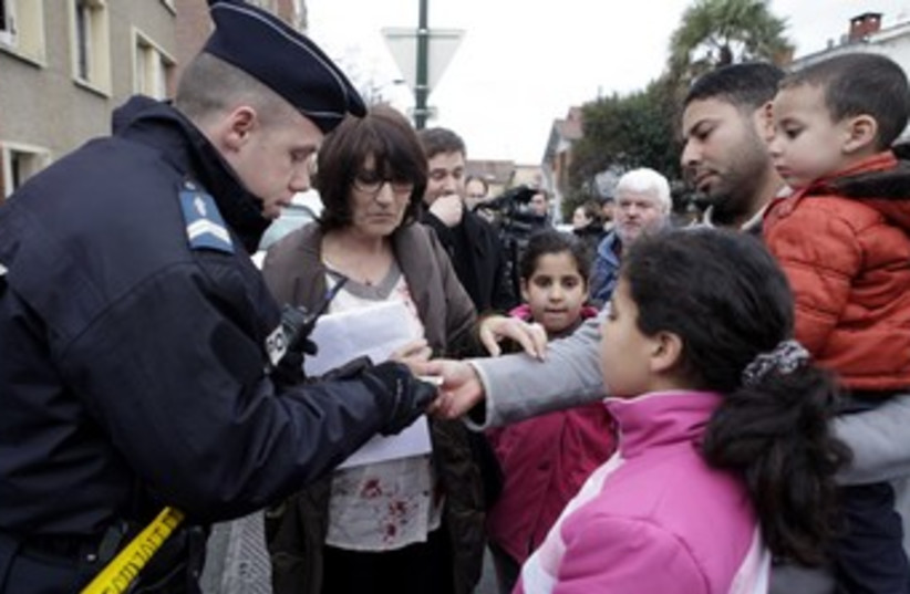 Police check identity papers of Toulouse residents 370 R (photo credit: REUTERS)