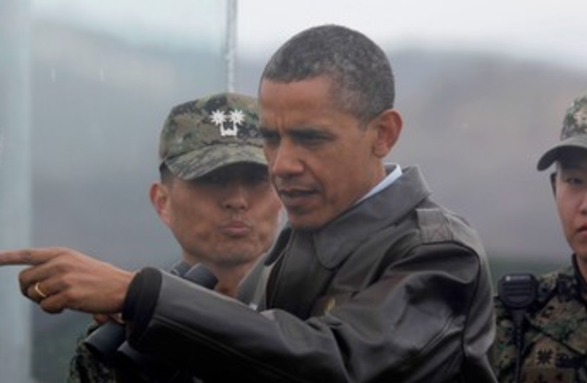 Obama at South Korea DMZ 370 (photo credit: REUTERS/Larry Downing)