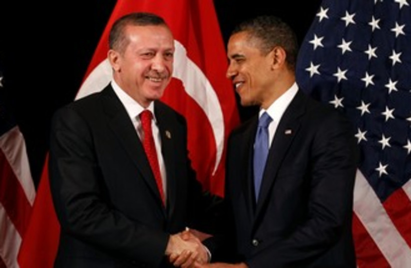 Obama, Erdogan shake hands with flags in background 370 (r) (photo credit: REUTERS/Larry Downing)