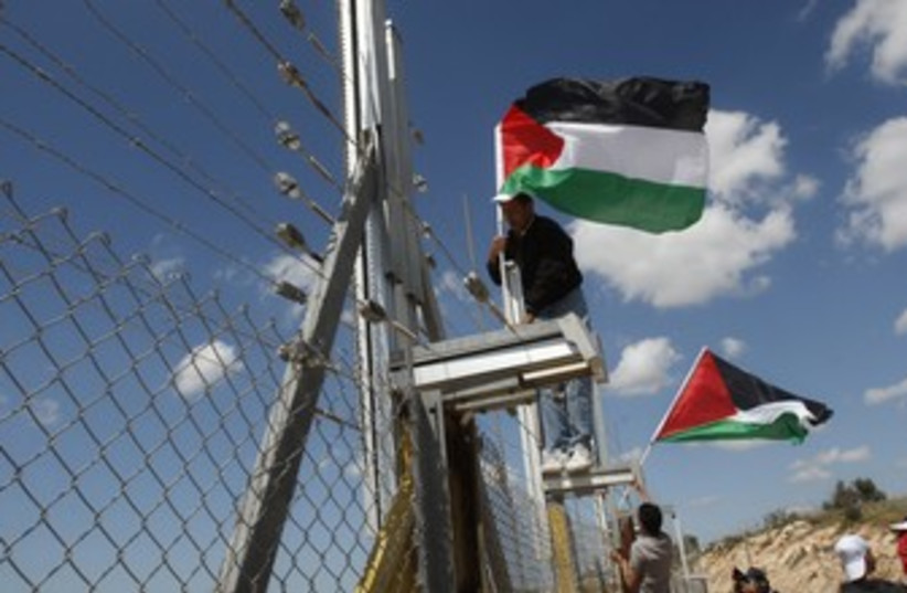 Palestinian Land Day protest 370 (photo credit: Mohamad Torokman / Reuters)
