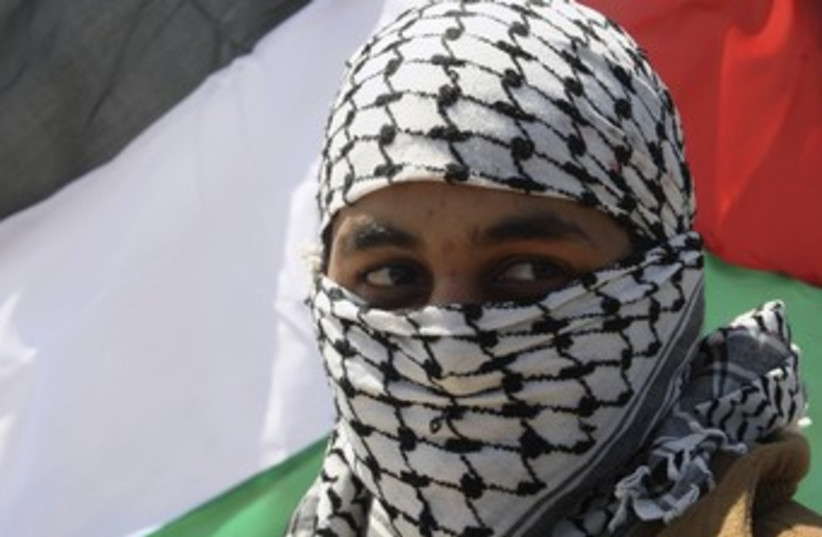 Palestinian at Land Day rally in Gaza City 370 (R) (photo credit: Ismail Zaydah / Reuters)