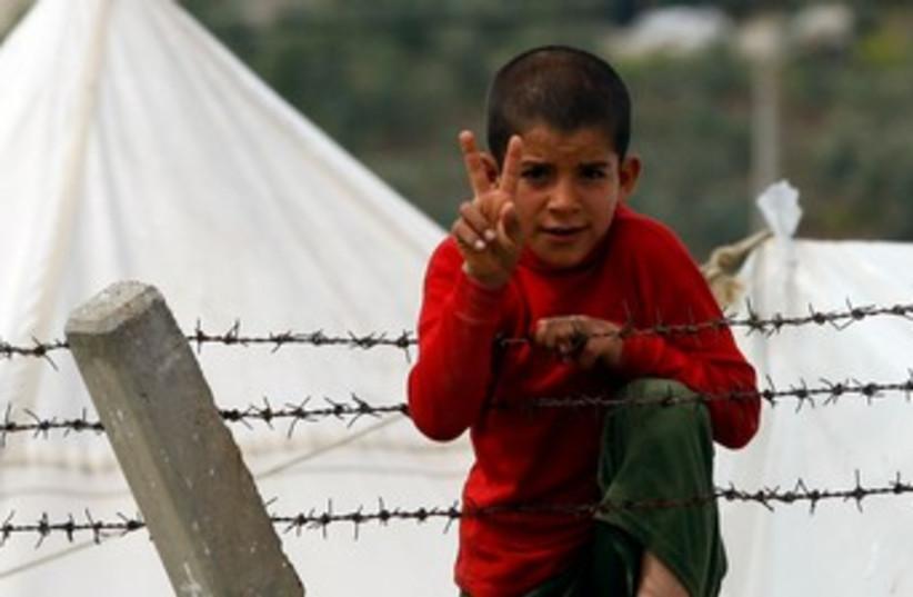 Syrian refugee boy on Turkish border 370 (photo credit: REUTERS/Osman Orsal)