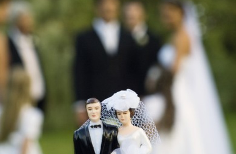 Wedding with blurred background (photo credit: Thinkstock/Imagebank)