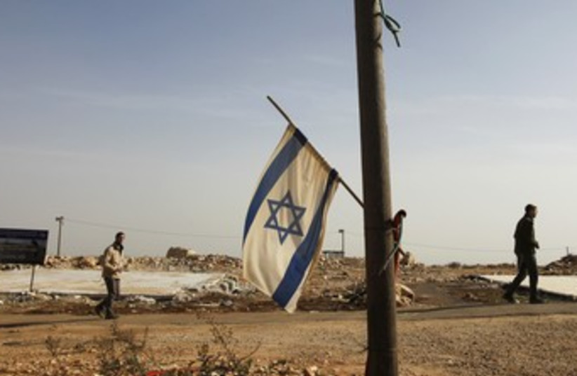 Israeli flag hangs off pole in Migron 370 R (photo credit: REUTERS)