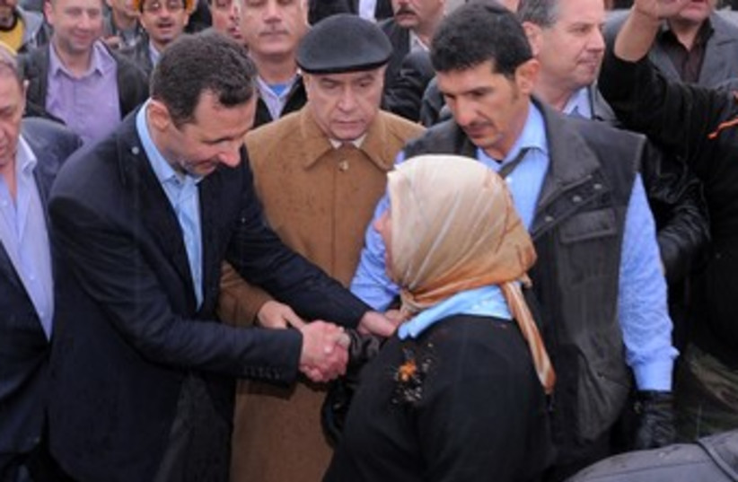 Assad visits Homs, Syria_370 (photo credit: Reuters)