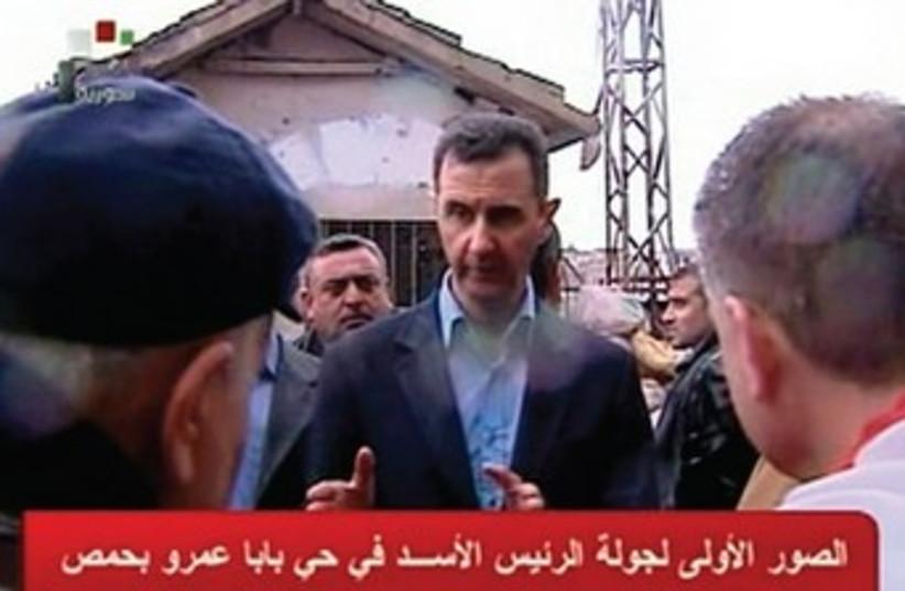 Assad visits Homs 370 (photo credit: Syrian TV/Reuters)