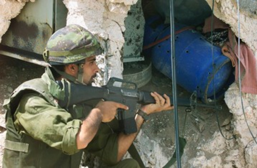 IDF soldier in Jenin during Operation Defensive Shield 390 R (photo credit: REUTERS)