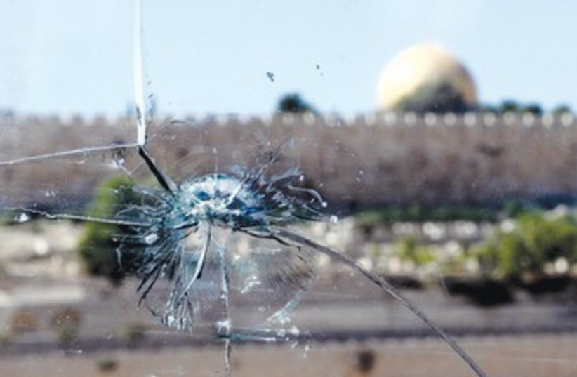 bullet hole in a car windshield in east Jerusalem_370 (photo credit: Marc Israel Sellem/The Jerusalem Post)