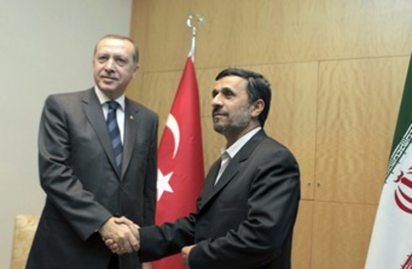 Iranian President Ahmadinejad with Turkish PM Erdogan 370 R (photo credit: REUTERS)
