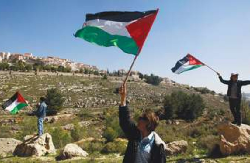 Palestinian flags waving in West Bank 370 (photo credit: Reuters)