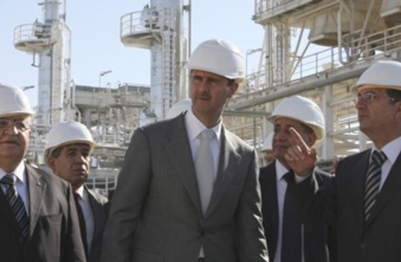 Assad tours natural gas plant near Homs_370 (photo credit: Reuters)