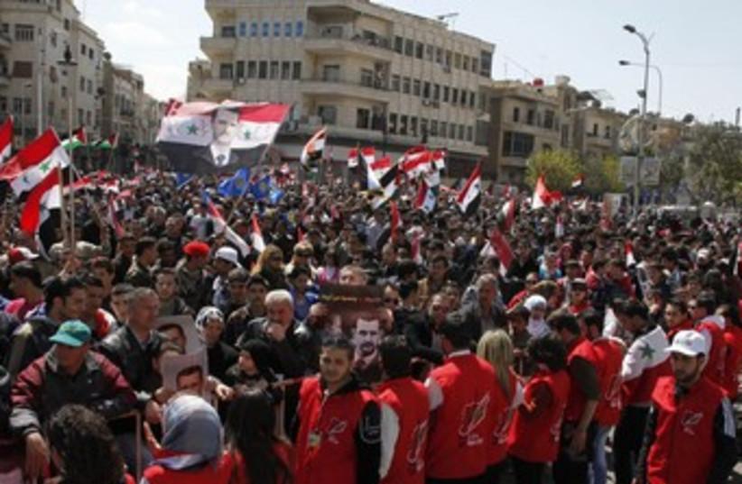 Land Day protest in Syria 370 (photo credit: REUTERS/Khaled al-Hariri )