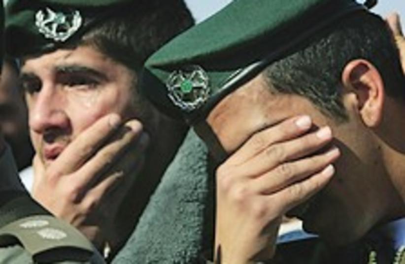 border police mourn 224. (photo credit: AP)